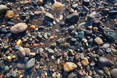 Wet pebbles on beach Royalty Free Stock Image
