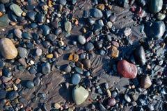 Wet pebbles on beach Stock Photo
