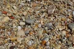 Wet pebbles on the beach. On the island of Skopelos Stock Photo