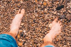 Wet pebbles on the beach. Vacation time royalty free stock photo