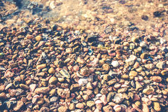 Wet pebbles on the beach vintage style Stock Image
