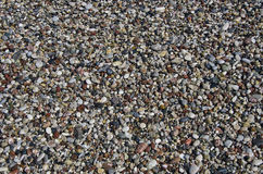 Wet Pebbly beach stone background in Mediterranean sea beach Stock Photos