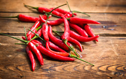 Wet peppers on wood Royalty Free Stock Photos