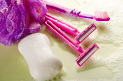 Wet pink razors and bar of soap Royalty Free Stock Photos