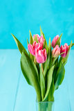 Wet Pink Tulip Flowers In Vase On Table Stock Photo