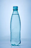 Wet plastic bottle of water Royalty Free Stock Images