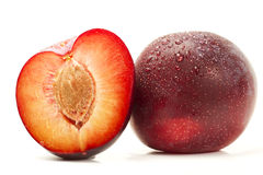 Wet plum and a half Stock Photo