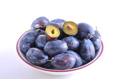 Wet plums in plate Royalty Free Stock Photos