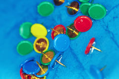 Wet pushpins on a blur background Royalty Free Stock Image