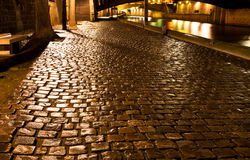 Wet quay in Paris at night Stock Photography