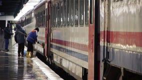 Wet rail station platform - editorial stock video
