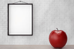 Wet Red Apple in front of Brick Wall with Blank Frame. Extreme closeup Stock Photography