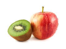 Wet red apple with half of kiwi. (white background). Fresh diet fruit. Healthy fruit with vitamins Stock Photos