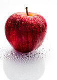 Wet Apple. Wet red apple on a wet white surface Royalty Free Stock Images