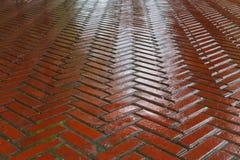 Wet red Brick Road Stock Image