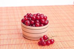 Wet red currant on brown wooden table royalty free stock image