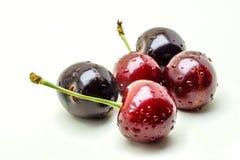 Wet ripe fresh cherries isolated on white background. Ripe fresh cherries isolated on white background Stock Photography