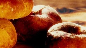 Wet ripe saturn peaches on a wooden table on a sunny day. Macro shot Royalty Free Stock Photos