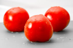 Wet ripe tomatoes. Wet ripe red tomatoes isolated on white background Stock Photos
