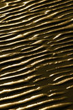 Wet ripple marks on sand. Abstract background of wet ripple marks on sand at low tide Royalty Free Stock Photography