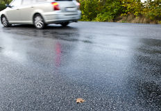 Wet road. Car driving on wet and icy and slippery road Royalty Free Stock Images