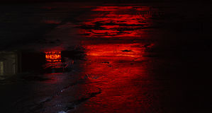 Wet road asphalt reflections, red light. Wet road asphalt reflections, red Royalty Free Stock Photography
