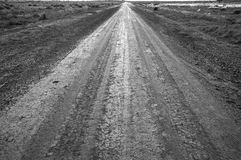 Wet road in Australian outback Royalty Free Stock Photography