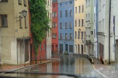 Wet road with colorful houses in gstad germany royalty free stock photo