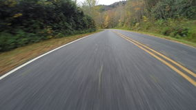 Wet Road Flies Behind on Blue Ridge Parkway stock footage