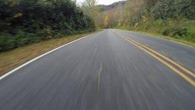 Wet Road Flies Behind on Blue Ridge Parkway stock footage