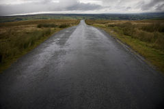 Wet road in Yorkshire Dales Yorkshire England Royalty Free Stock Photo