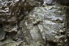 The wet rock walls Stock Images