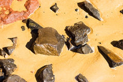 Wet Rocks. Of various colours in a sandy beach Royalty Free Stock Photography