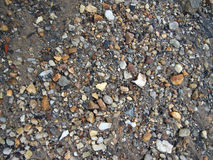 Wet Rocks, Sand, and dirt Stock Image