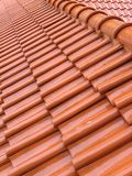 Wet Roof Tiles. Red roof tiles after a downpour stock photo