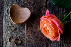 Wet rose, heart and wedding rings Royalty Free Stock Image