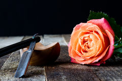 Wet rose on a wooden table. Wet rose on wooden table black background Stock Image
