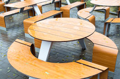 Wet round outdoor cafe tables on the street Royalty Free Stock Image