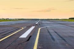 Wet Runway airport airplane strip plane asphalt road line Stock Images