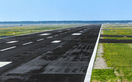 Wet runway at airport just before take off Stock Photography