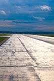 Wet runway early morning Royalty Free Stock Photo