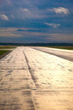 Wet runway early morning Stock Images