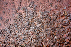 Wet Rusty Steel Metal Rough Surface Background. Wet and soaked with water rough and rusty raw metal surface with damaged rust corrosion on old exposed steel Stock Image
