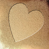 Wet sand. Heart in wet sand with some fine grain in it Stock Photos