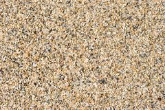 Wet sand. Closeup of orange and black wet sand grains royalty free stock images
