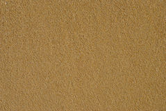 Wet Sand. Background of high-contrast smooth wet sand from top Stock Images