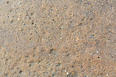 Wet sand background. Stock Photos
