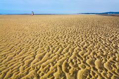 Wet sand during low water on beach of English Channel Royalty Free Stock Images