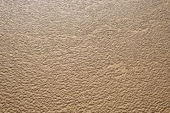 Wet sand organic natural texture pattern beach wave backdrop Stock Images