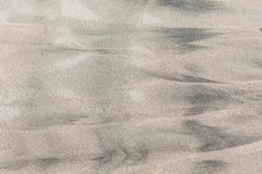 Wet sand patterns. At beach Stock Images